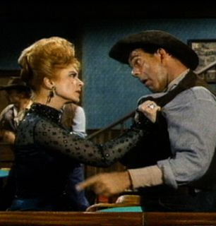 Miss Kitty lets them know - Gunsmoke Picture