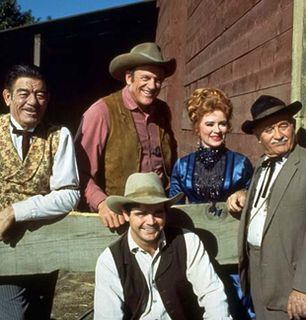The cast poses by the - Gunsmoke Picture