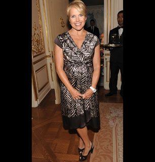 CBS anchorwoman Katie Couric stops - How'd You Get So Rich? Picture