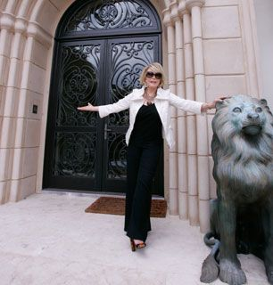 Here kitty kitty Joan poses - How'd You Get So Rich? Picture