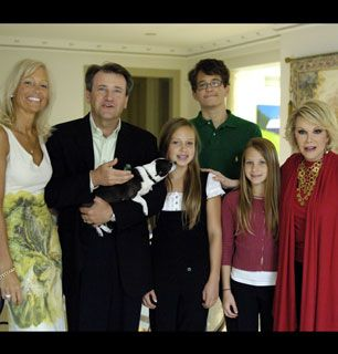 The Herjavec family poses proudly - How'd You Get So Rich? Picture