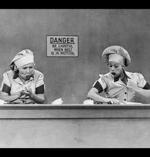 Trading places: After the boys attempt to do housework, Lucy and Ethel try to earn a living at the chocolate factory. (Photo courtesy CBS Photo Archive/Getty Images) - I Love Lucy Picture